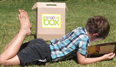 Child with Bookoo Box